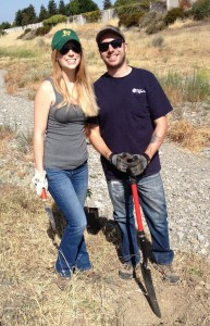 Heather Smith and Ian Patience pause after planting a young buckeye.