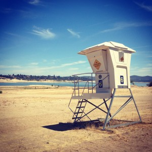 A lifeguard stand that normally sits on the edge of the water at XX Folsom Lake is now hundreds of feet away.